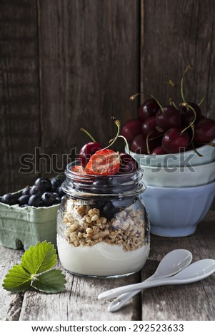 Granola with greek yogurt in a mason jar