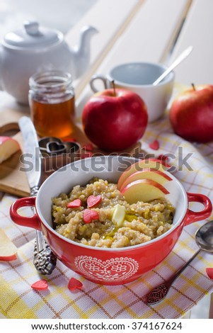 Granola with red apples, honey and sugar hearts