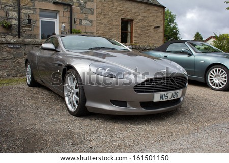 GRANTOWN, SCOTLAND - SEPTEMBER 1: Aston Martin DB9 on September 1, 2013 in Grantown, Scotland. The DB9 was the first model built at Aston Martin's Gaydon facility. - stock photo