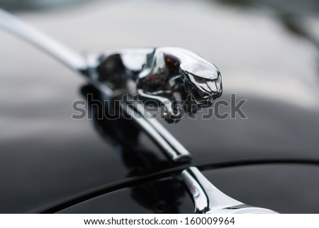 GRANTOWN, SCOTLAND - SEPTEMBER 2: Jaguar Sign on September 2, 2012 in Grantown, Scotland. Founded in 1922 Jaguar is a British luxury car manufacturer based in Coventry, England. - stock photo