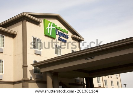 Grantville, PA, USA - February 20, 2012 : Sign over entrance of a Holiday Inn Express hotel - stock photo