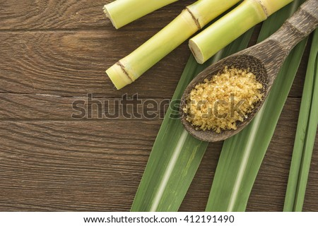 granulated brown sugar produced from sugar cane, top view. Agriculture Industry concept. - stock photo