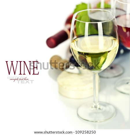 Grape and cheese with a bottles and glasses of red, rose and white wine  (easy removable sample text)