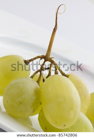 Grape berries on a white background
