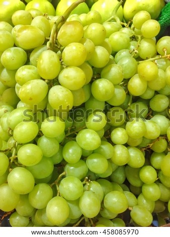 grape fruits. Grapes are several thousand. The taste is sweet. color with red, purple and green.