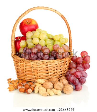 Grape in basket with nuts isolated on white - stock photo