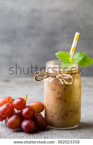 Grape smoothie, on the grey  background.