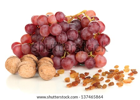 Grape with nuts isolated on white - stock photo