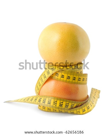 grapefruit and measuring tape dieting concept isolated on white background - stock photo