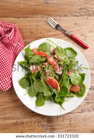 Grapefruit and spinach salad - stock photo