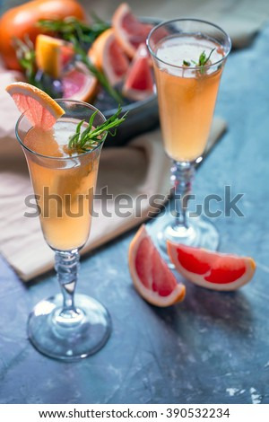 Grapefruit cocktail served in flute glasses. - stock photo