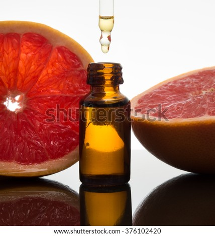 Grapefruit, essence, essential oil, extract, in amber glass bottle with dropper