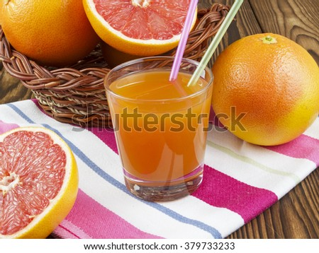 grapefruit juice in glass on wooden table