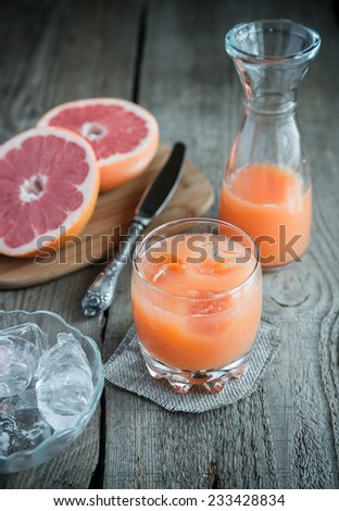 Grapefruit juice on the wooden table - stock photo