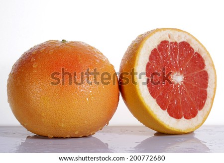 Grapefruit with half isolated on white background - stock photo