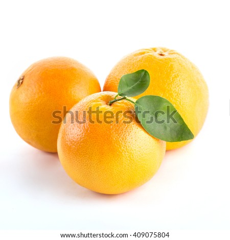 Grapefruit with leaves isolated on white background - stock photo