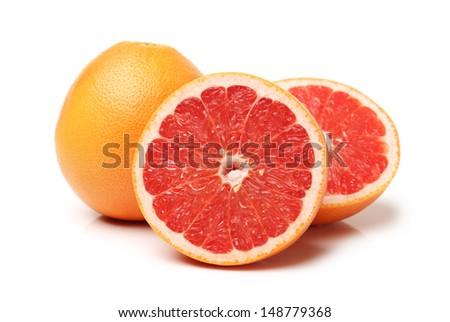 Grapefruit with segments on a white background  - stock photo