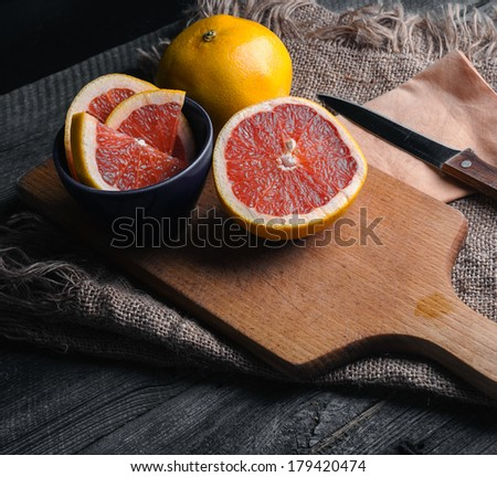 grapefruits on wood table. filtered look