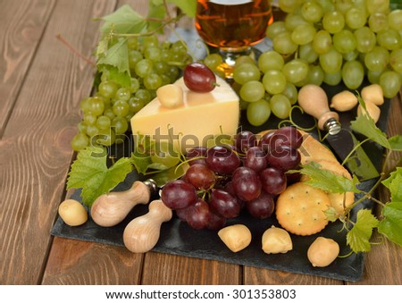 Grapes and cheese on a brown background