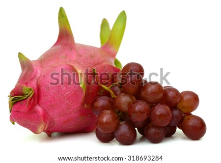 Grapes and Dragon fruit isolated on white background - stock photo