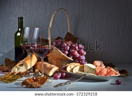 grapes , bread and snacks to red wine - stock photo