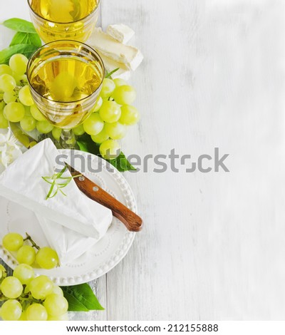 grapes, brie cheese and two glasses of wine.copy space background.health and diet food - stock photo