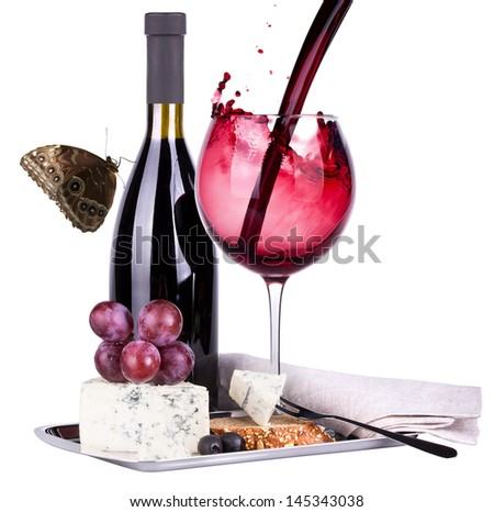 grapes, butterfly and wine glass isolated on a white background