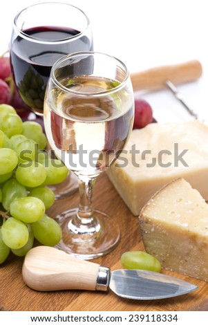 grapes, hard cheese and two glasses of wine, vertical - stock photo