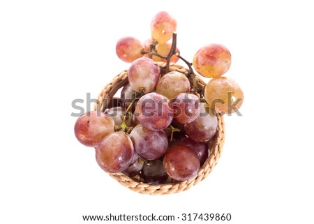 Grapes in a basket on a background White - stock photo