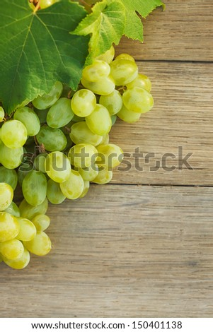 Grapes on a wooden barrel. Macro image.