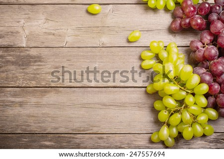 Grapes on a wooden table - stock photo