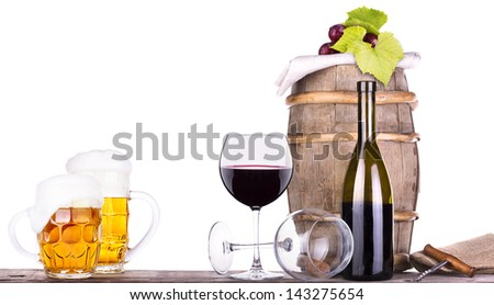 grapes on a wooden vintage barrel with corkscrew and beer glass isolated on a white background - stock photo