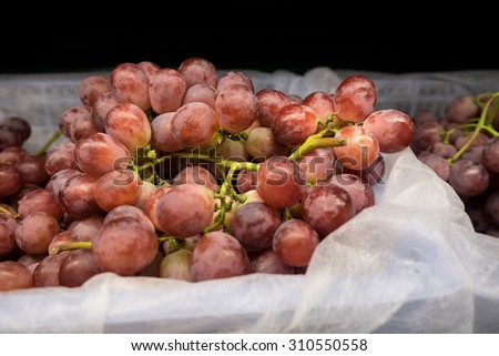 Grapes on bucket in the market. - stock photo