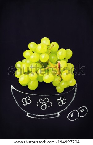 Grapes on chalkboard with hand drawing bowl