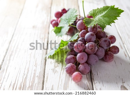 Grapes on wooden table, close-up. - stock photo