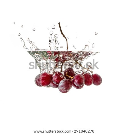 Grapes splash on water, isolated on white background - stock photo