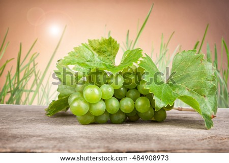 grapes, white wine on a wooden table