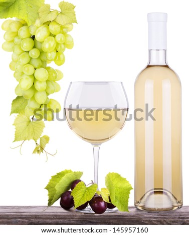 grapes with glass of white wine and a bottle on a wooden vintage table isolated over white background