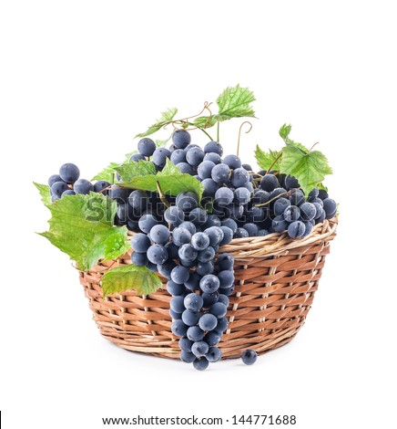 Grapes with leaves in wicker basket, Isolated on white background - stock photo