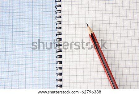 graph grid paper and notebook with pencil