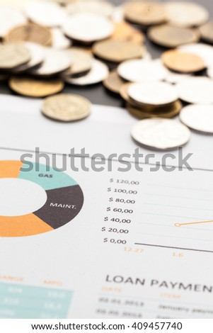 Graph Of Stock Market With Stacks Of Coins - stock photo