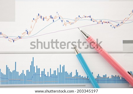 Graph Of Stock Price And Ballpoint Pen