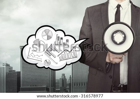 Graph on speech bubble with businessman and megaphone on city background