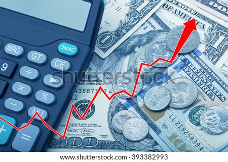 Graph showing economy strengthening of United States bank notes and coins with a calculator