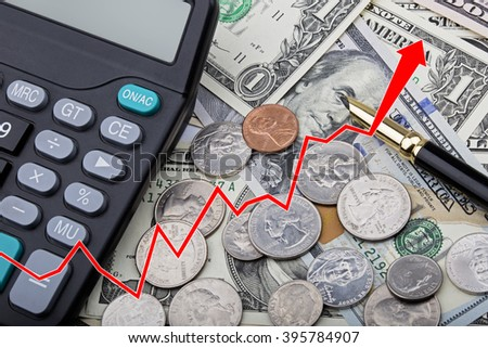 Graph showing United States bank notes and coins with a calculator and pen