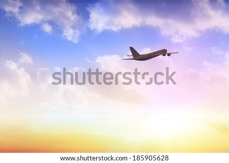 Graphic airplane flying over beautiful orange and blue sky