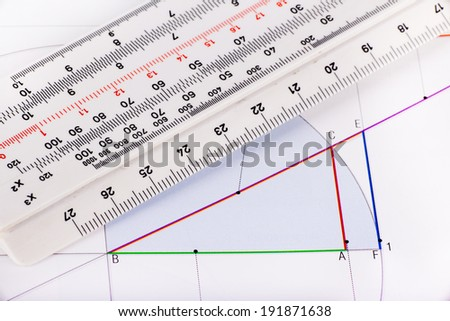 Graphic and ruler for calculation on white paper  - stock photo