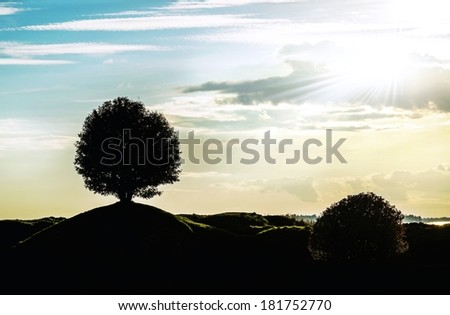 Graphic black and white landscape silhouette with a signal tree - stock photo