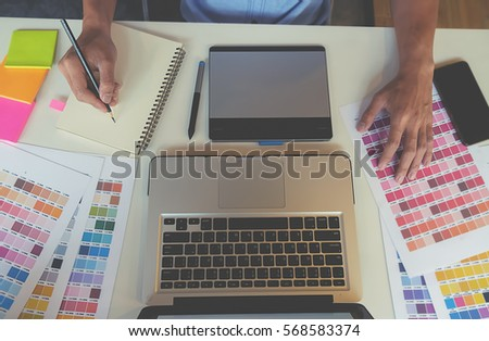 graphic design and color swatches and pens on a desk architectural drawing with work tools - Graphic Design Desks