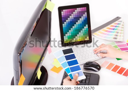 Graphic designer at work. Color swatch samples. - stock photo